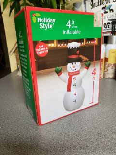 4ft tall. Self Inflatable Snowman. Lights up. Indoor/outdoor use!