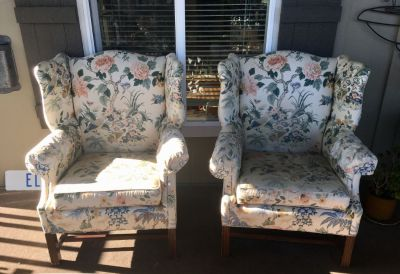 2 matching high back chairs with floral print