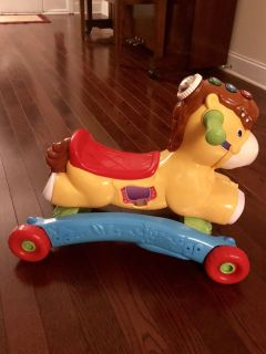 LIKE NEW VTECH rock and ride horse