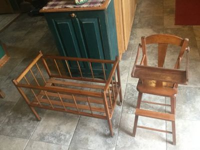 Two vintage wooden furniture doll pieces. High chair with tray that goes up and down and crib on...