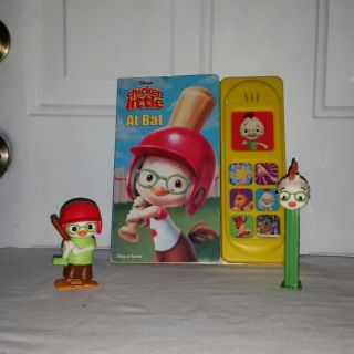 Chicken Little at Bat. Talking book works great, sm wind up with bat works, another sm figure and a very collectable PEZ candy dispenser.
