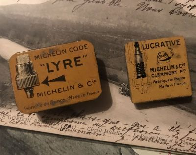 Two Small Michelin Tins