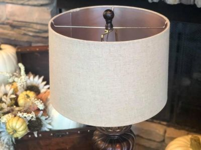 Ornate antique bronze urn lamp with light brown linen lamp shade & coordinating finial