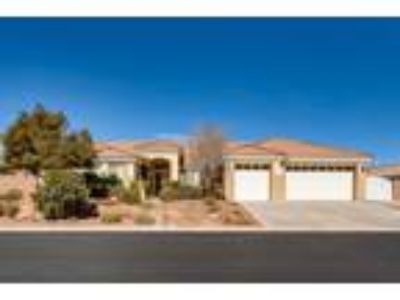 Gorgeous, hard to find gated 1 story estate situated on beautifully landscaped