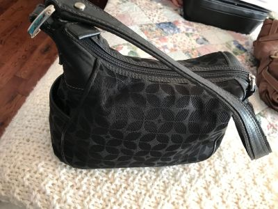 Nice black bag with phone or cigarette pockets on the ends.