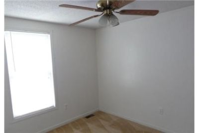 Cute end unit town home with three bedrooms and two and a half baths.