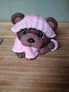 Vintage bear with pink clothes and hat