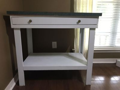 Craft/work table 40.25 wide and 3ft tall. Has hooks to hang scissors or crafting supplies on side and a nice large drawer.