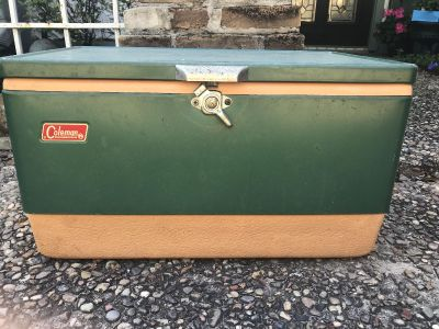 Vintage Coleman cooler with built-in bottle opener - perfecting for fishing and boating