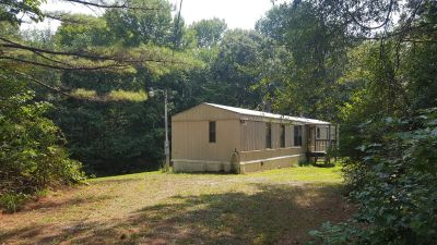 1985 Mobile Home on .84 acre