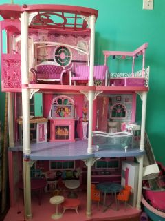 Barbie house with furniture and barbies