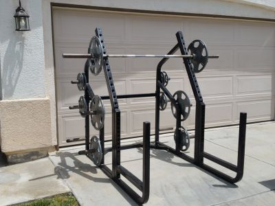 Gym rack by cybex and weights by Hampton (delivery options available)