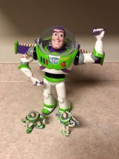 Like new talking light up buzz light-year and two miniatures