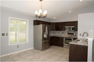 BEAUTIFUL NEWLY RENOVATED fenced in 4 bedroom 2 fu