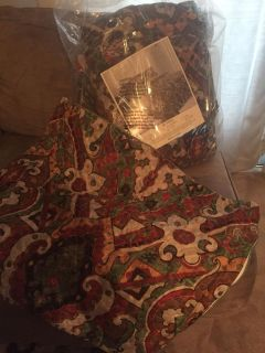 New in bag, reversible Queen size quilt & two pillow shams.