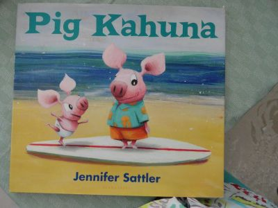 LARGE ''PIG KAHUNA'' HARDCOVER BOOK WITH DUST COVER