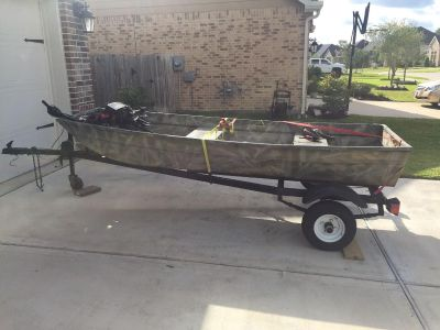 10 foot Jon boat with trailer and trolling motor.