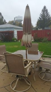 Patio table and 4 chairs and umbrella