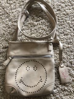 Girls cross body handbag. Used one time. Great condition. No stains inside at all.