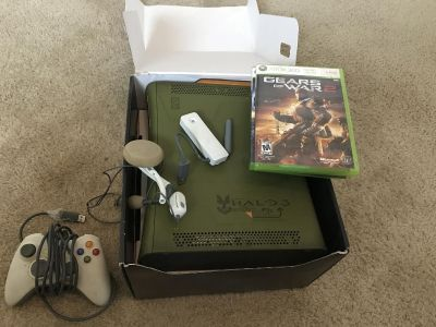 XBox 360 green and gold limited edition. Includes box, cords, 1 remote, ear piece, wireless connector as well as 4 games.