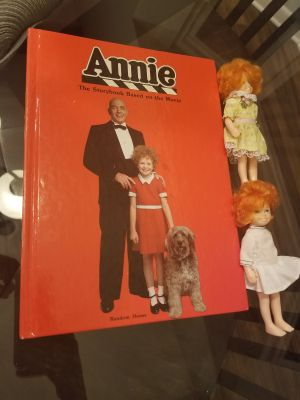Two Annie dolls with Annie storybook