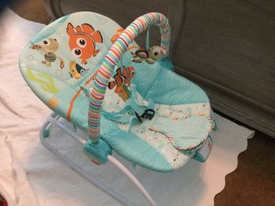 Bright Starts Baby and up. Infant seat/bed/rocker with mobile and music