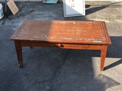 Great coffee table. $10.00 with drawer.