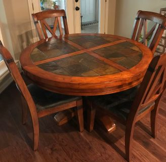 Solid wood with slate top table and 6 chairs and leaf
