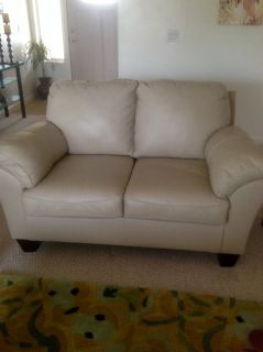 Matching leather love seats . Light color