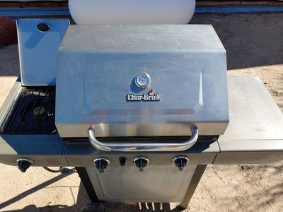 Used Charbroil Three burner BBQ with side burner.