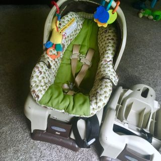 Graco car seat with two bases and toys