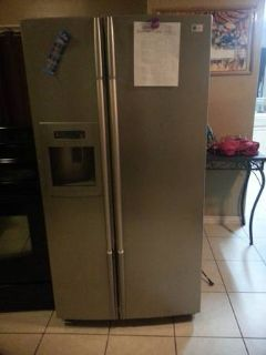 electric stove and 2 door refrigerator