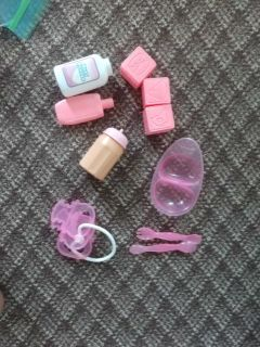 Bag of baby doll items
