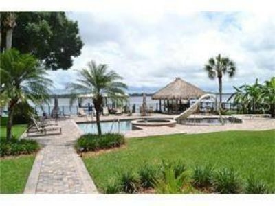 4990 Moore Street Tarpon Springs Four BR, Live the lakefront