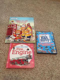 Two hard cover fire truck books and one DVD