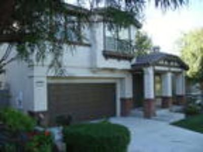 Wonderful Four BR single family home in the gated community of Sierra Ridge
