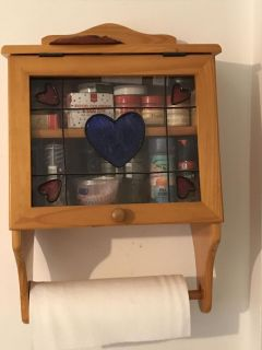 Spice rack with paper towel holder.