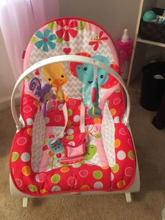 Fisher Price rocker, can sit up or lay down for infants. Perfect condition!