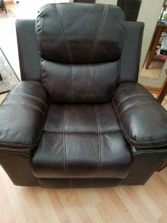 Brown Leather Swivel Rocker Recliner
