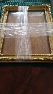 Antique picture frame with bowed glass
