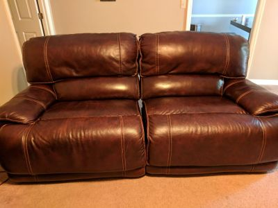 Leather sofa with motorized recline