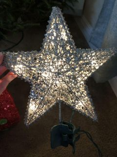 Silver sequin wrapped star tree topper. Purchased from Target