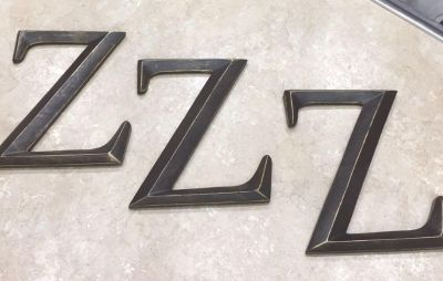 3 large Z letters. Brown with antique gold colored accent which gives a distressed look. I used in bedroom as wall decor.10 x12 .See below