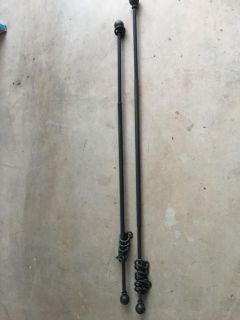 two black metal curtain rods 31 max 54