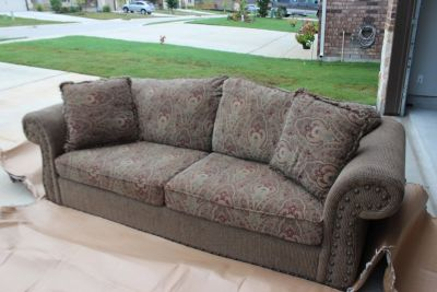 Three person sofa with two pillows