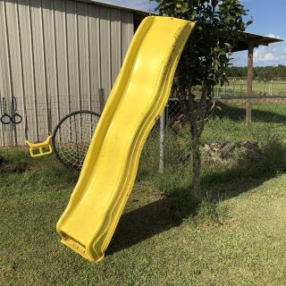 Plastic slide for playhouse or treehouse.