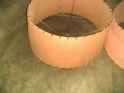 Ventage leather salmon colored lamp shades.