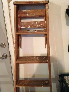 5 foot Davidson wood step ladder, has paint spots, but otherwise in good condition