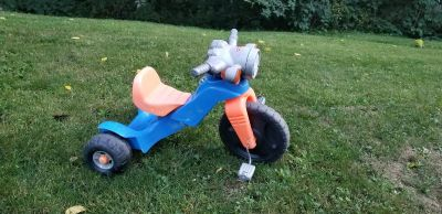 Motorcycle tricycle. Makes motorcycle sounds!