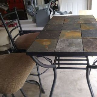 Stone top Table with 4 - swivel bar stools.
